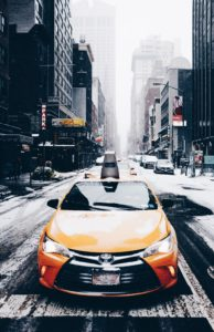 a yellow cab in the winter in Manhattan