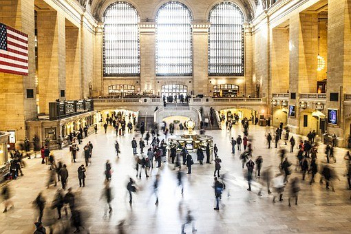 people at the grand central station after moving from VA to NY