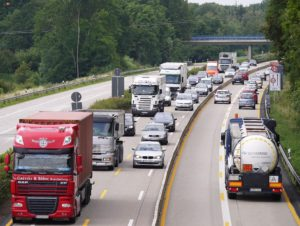 A busy highway packed with cars and trucks.