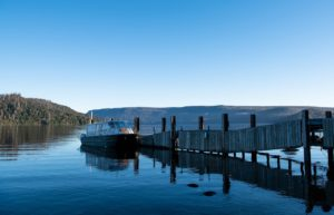 A small ferry and a dock: it is possible after a move to the country. Are you up for it?