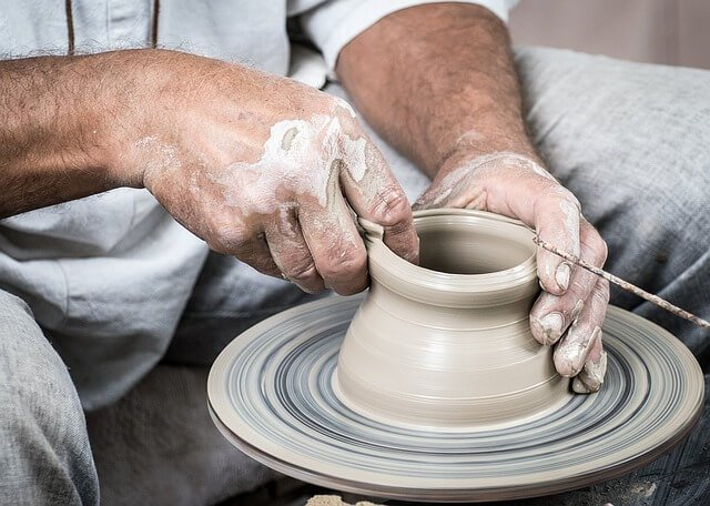 Man making pottery will call fine art movers NYC