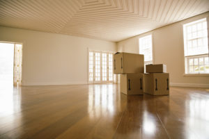 Moving boxes in an empty room.