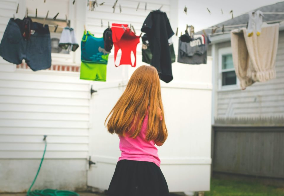 girl looking at clothes