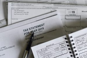 Filling in tax statements to deduct moving costs.