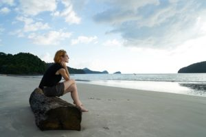 Woman on a beach alone.