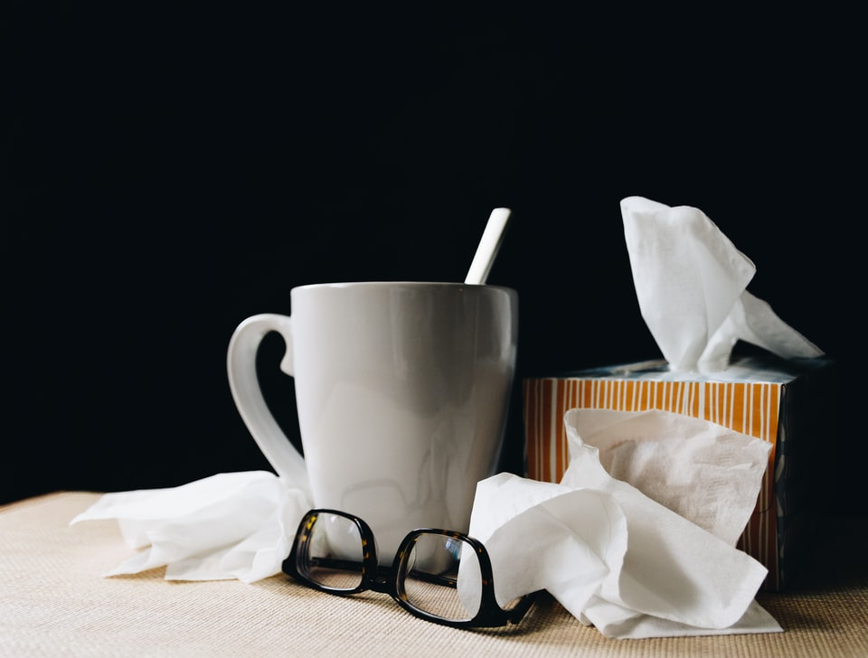 Things you'll need when Moving while sick - tissues, cup of tea, glasses.