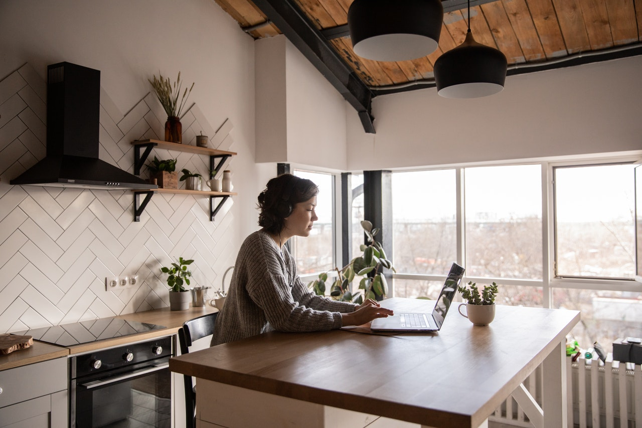 Girl looking online how to maximize space in her new Manhattan apartment