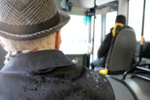 Elderly man wearing black coat