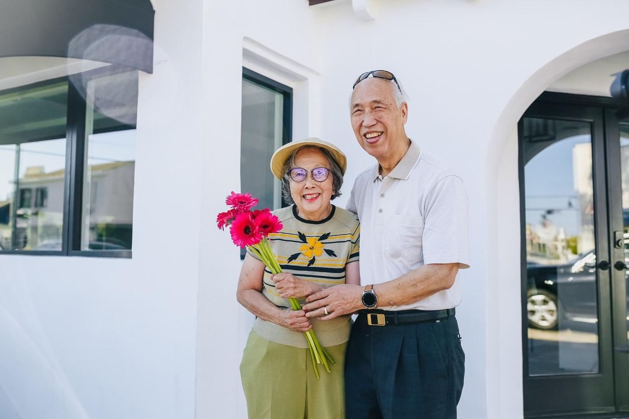 Happy senior couples moving to Manhattan