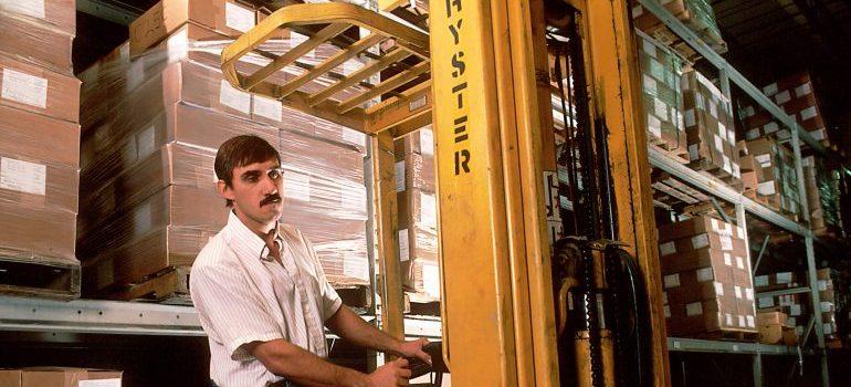 A man in a storage unit