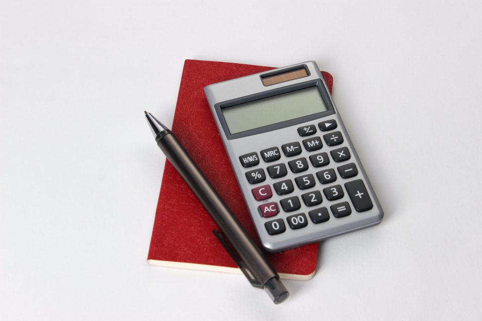 calculator and red notebook