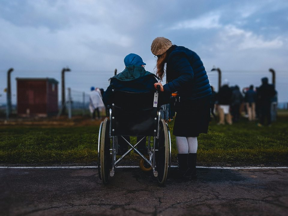 person telling to a disabled person about Moving tips for people with disabilities