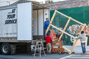 Movers loading a moving truck
