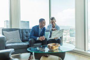 two men reading how to pick the best Manhattan rental broker