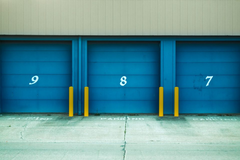 Organizing Business Inventory in Storage with blue doors
